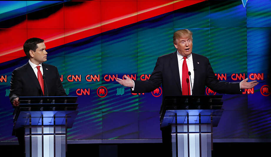 Republican presidential candidate, businessman Donald Trump, right, answers a question, as Republican presidential candidate, Sen. Marco Rubio, R-Fla., listens, during the Republican presidential debate sponsored by CNN, Salem Media Group and the Washington Times at the University of Miami, Thursday, March 10, 2016, in Coral Gables, Fla. (AP Photo/Wilfredo Lee)