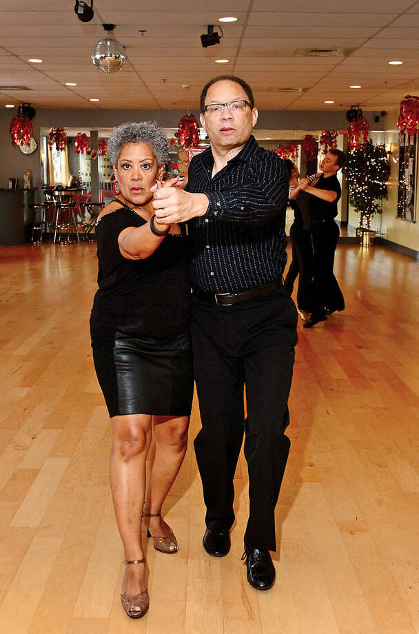 Hour photo / Erik Trautmann Norwalk residents Chuck and Cheryl Presbury have been married for 30 years and ballroom dancing at Fred Astaire Dance Studio in Norwalk for the last five.