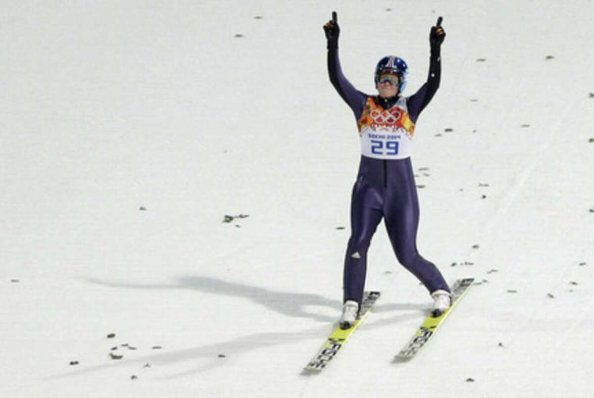 Germany's Carina Vogt celebrates after her first attempt during the women's normal hill ski jumping final at the 2014 Winter Olympics, Tuesday, Feb. 11, 2014, in Krasnaya Polyana, Russia. (AP Photo/Matthias Schrader)