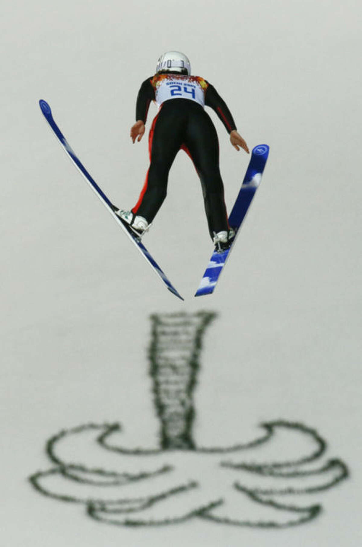 France's Coline Mattel makes her first attempt during the women's normal hill ski jumping final at the 2014 Winter Olympics, Tuesday, Feb. 11, 2014, in Krasnaya Polyana, Russia. (AP Photo/Gregorio Borgia)