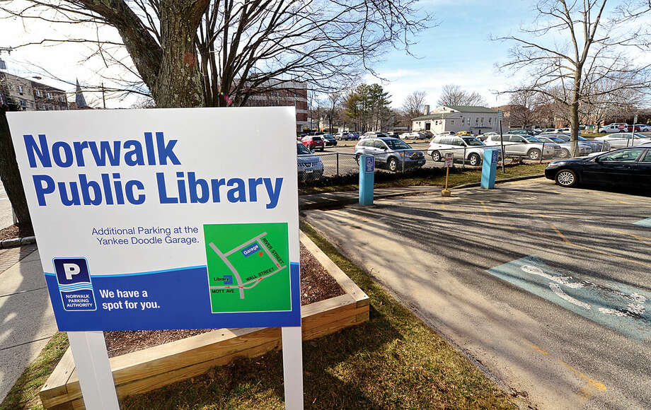 Hour photo / Erik Trautmann The Norwalk Zoning Commission Plan Review Committee will review a proposed 69-unit apartment complex for parking lot adjacent Norwalk Main Library with additionbal parking spaces for the development at 3 and 5 Mott Ave.