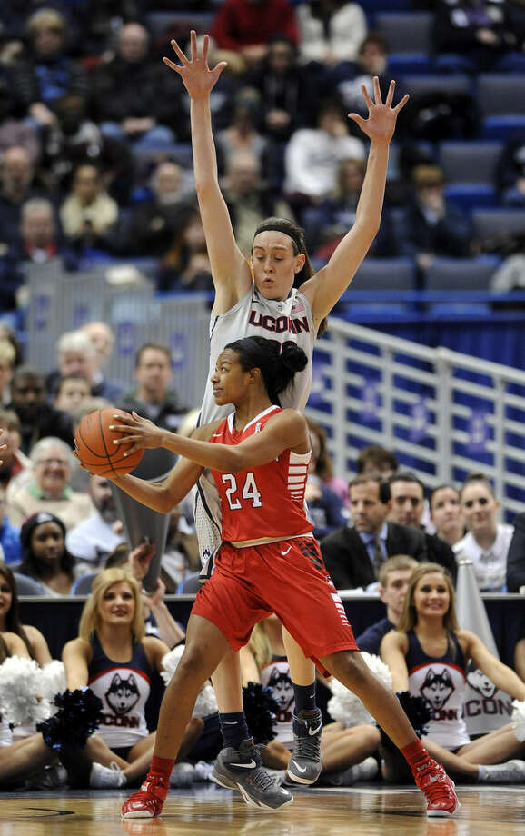Connecticut's Breanna Stewart (30) guards Houston's Mariah Mitchell (24) during the first half of an NCAA college basketball game in Hartford, Conn., on Tuesday, Feb. 17, 2015. (AP Photo/Fred Beckham)