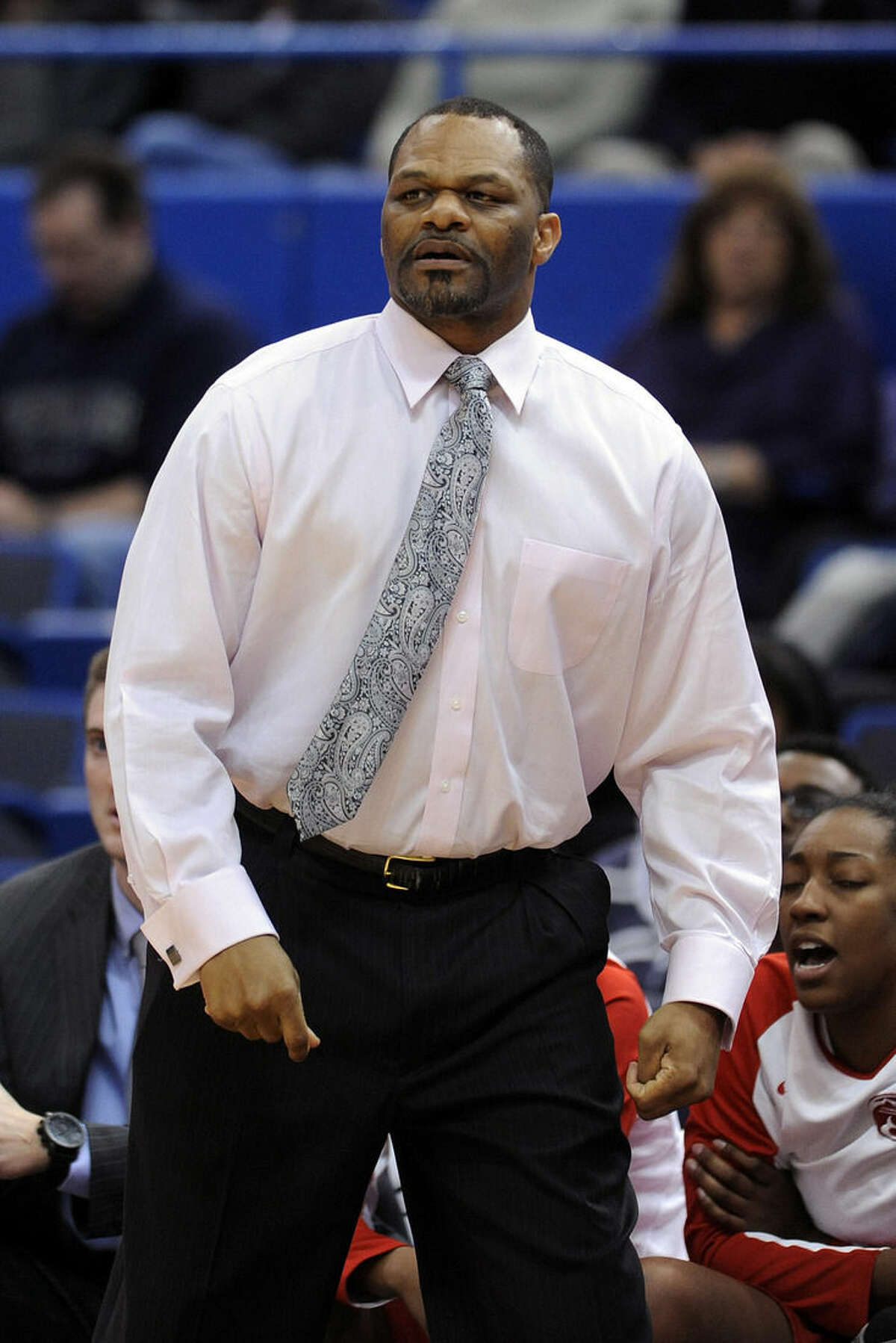 Houston head coach Ronald Hughey reacts during the first half of an NCAA college basketball game against Connecticut in Hartford, Conn., on Tuesday, Feb. 17, 2015. (AP Photo/Fred Beckham)