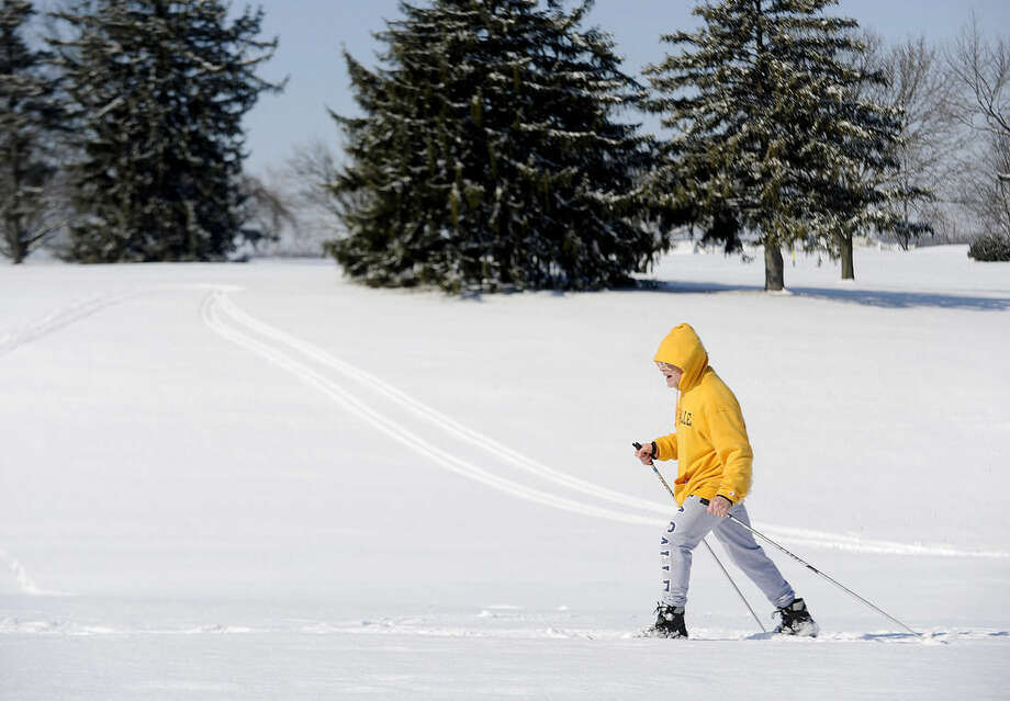 Steve Stahley cross-country skis on the McDaniel College golf course, Tuesday, Feb. 17, 2015, in Westminster, Md. Hundreds of thousands of people are without power in the Mid-Atlantic region and the South, after a snow and ice storm that also caused treacherous road conditions. (AP Photo/The Carroll County Times, Dave Munch)