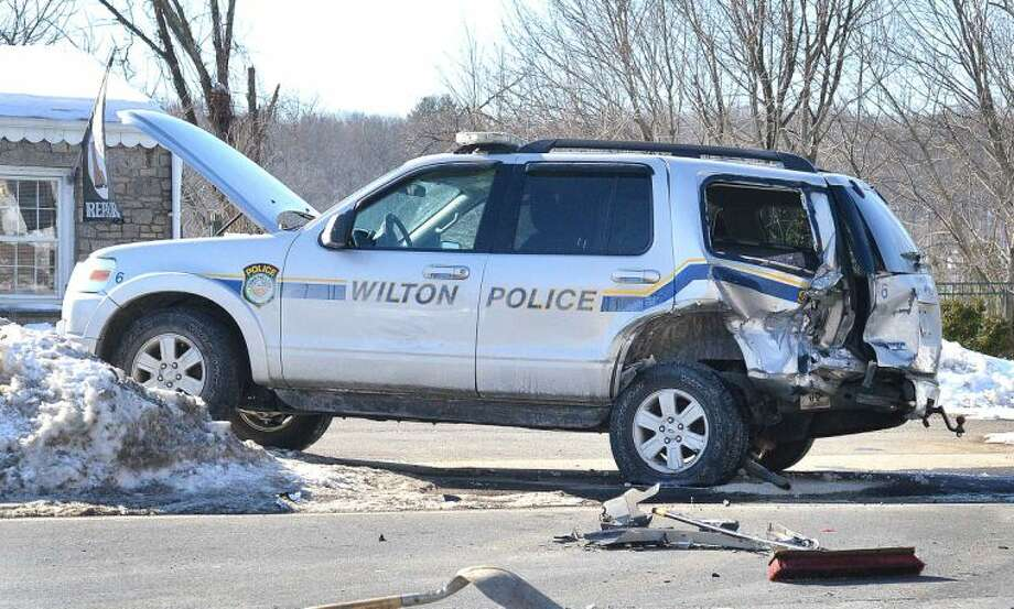 Hour Photo/Alex von Kleydorff Wilton Police investigate an accident involving one their SUV Police vehicles on Rt. 7 on Tuesday