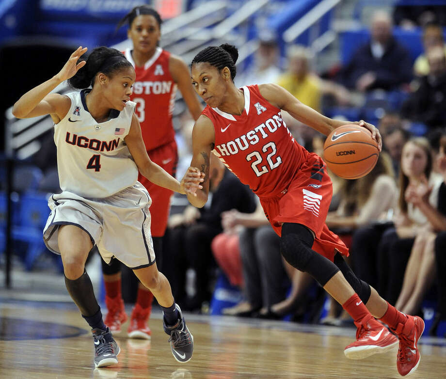 Connecticut's Moriah Jefferson (4) guards Houston's Marche' Amerson (22) during the first half of an NCAA college basketball game in Hartford, Conn., on Tuesday, Feb. 17, 2015. (AP Photo/Fred Beckham)