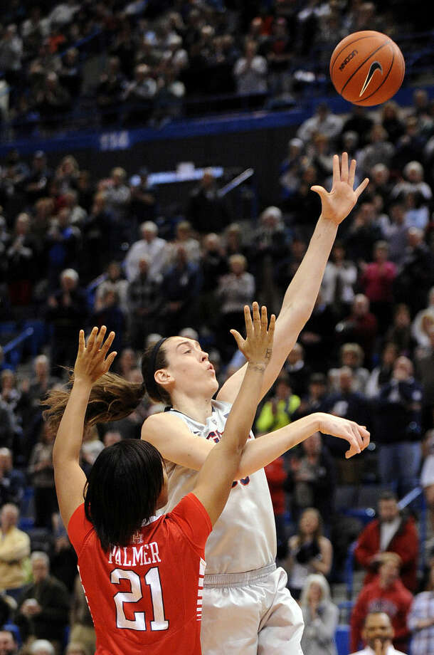 Connecticut's Breanna Stewart (30) shoots over Houston's Jessieka Palmer (21) during the first half of an NCAA college basketball game in Hartford, Conn., on Tuesday, Feb. 17, 2015. (AP Photo/Fred Beckham)