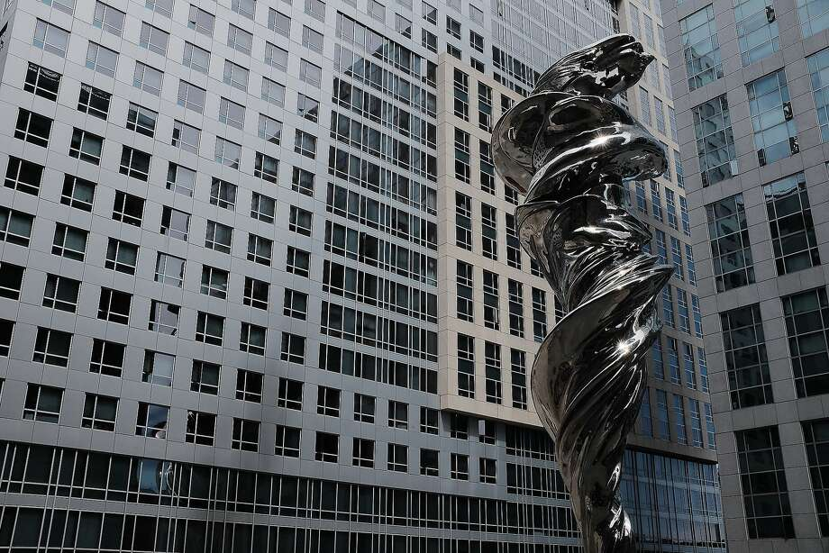 "The newly completed sculpture ""Venus,"" depicting goddess of love and beauty wrapped in a flowing robe, stands in Trinity Place in San Francisco. The 92-foot-tall work is by Lawrence Argent. Photo: Mike Moffitt/SFGATE"