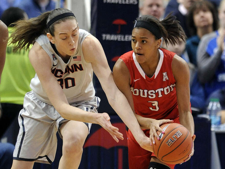 Connecticut's Breanna Stewart (30) and Houston's Bianca Winslow (3) fight for a loose ball during the first half of an NCAA college basketball game in Hartford, Conn., on Tuesday, Feb. 17, 2015. Stewart scored a game-high 26 points in Connecticut's 85-26 victory. (AP Photo/Fred Beckham)