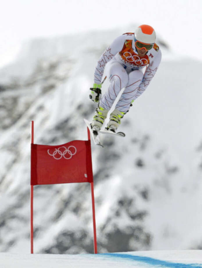 United States' Bode Miller jumps during the men's downhill at the Sochi 2014 Winter Olympics, Sunday, Feb. 9, 2014, in Krasnaya Polyana, Russia. (AP Photo/Charles Krupa)