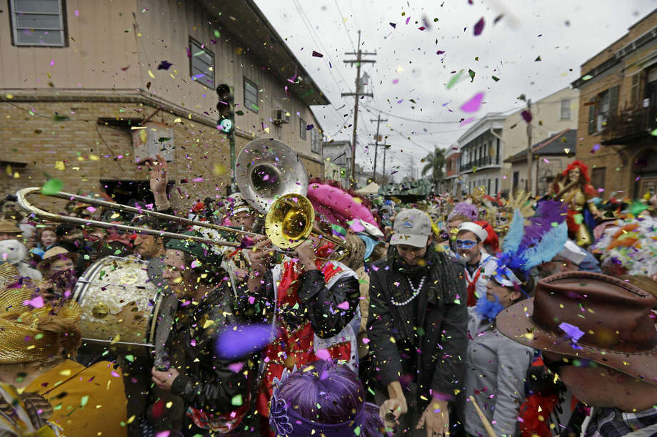 Revelers play brass band music as they begin the march of the Society of Saint Anne Mardi Gras parade, on Mardi Gras in New Orleans, Tuesday, Feb. 17, 2015. Revelers in glitzy costumes filled the streets of New Orleans for the annual fat Tuesday bash, opening a day of partying, parades and good-natured jostling for beads and trinkets tossed from passing floats. (AP Photo/Gerald Herbert)