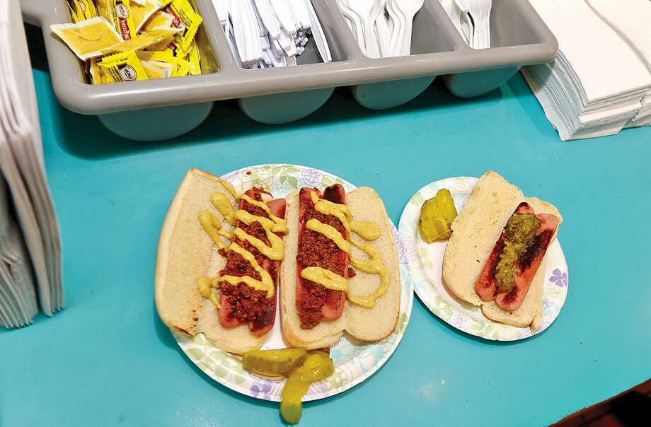 Hour photo / Erik Trautmann Chili dogs are a customer favorite at Pat's Hubba Hubba which is closing down Sunday after nearly 50 years of operation.
