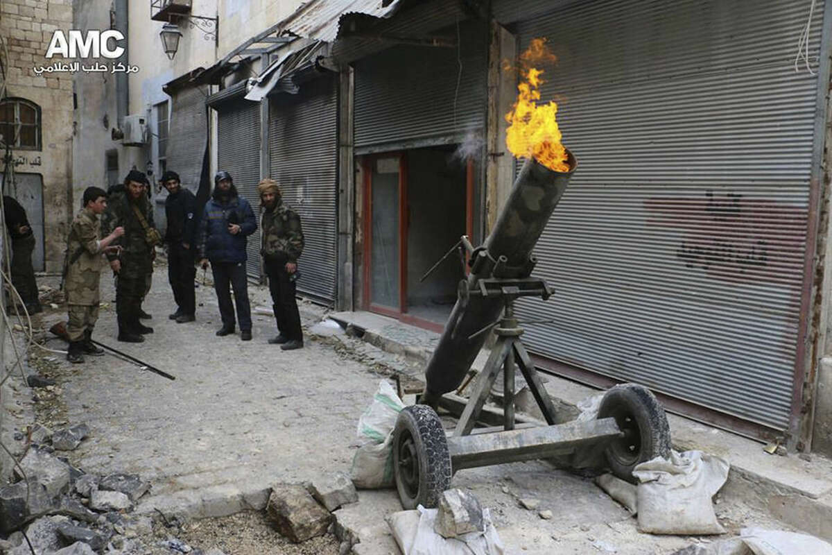 This photo provided on Sunday Feb. 15, 2015 by the Syrian anti-government activist group Aleppo Media Center (AMC), which has been authenticated based on its contents and other AP reporting, shows Syrian rebels firing locally made shells against the Syrian government forces, in Aleppo, Syria. Activists say Syrian rebels have regained much of an area north of the city of Aleppo that they lost to government troops in fierce fighting the previous day. The clashes have left more than 100 dead on both sides. (AP Photo/Aleppo Media Center, AMC)