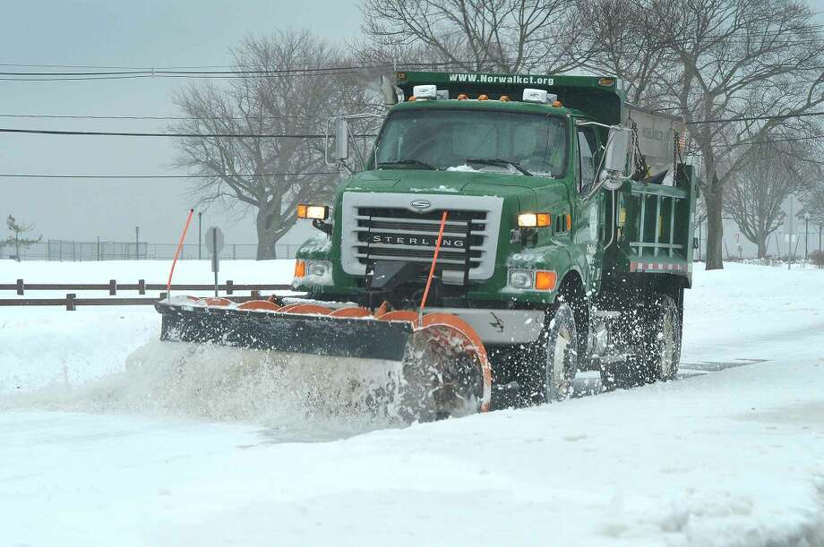Hour Photo/Alex von Kleydorff City plows are busy on the roads of Norwalk Monday