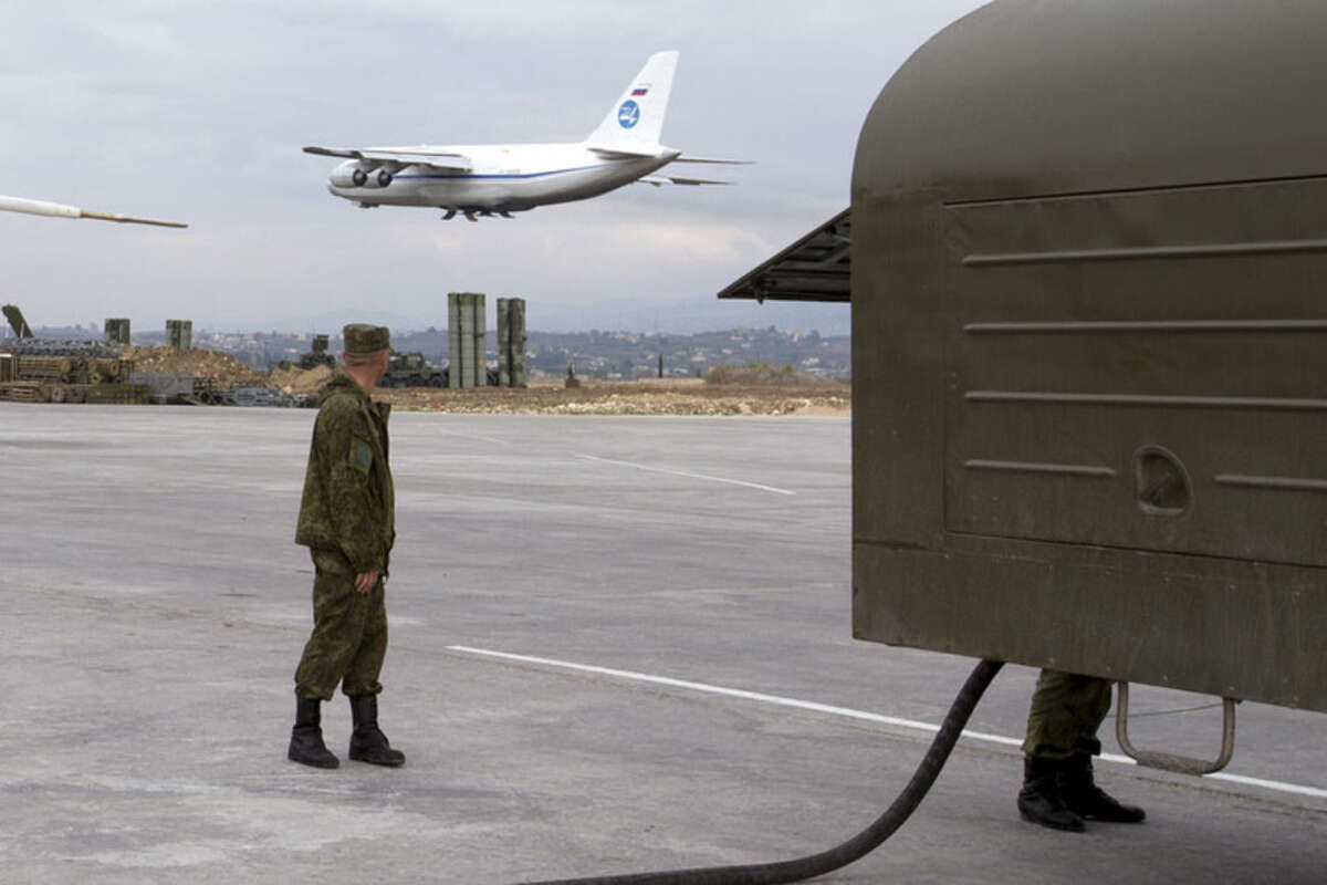 FILE - In this file photo taken Dec. 16, 2015 and provided by the Russian Defense Ministry Press Service, a Russian An-124 Ruslan cargo plane takes off from Hemeimeem air base in Syria. Russia's defense ministry said Tuesday, March 15, 2016, that the first group of warplanes stationed at the Russian air base in Syria has left for home following a pullout order from President Vladimir Putin. (Vadim Savitsky/Russian Defense Ministry Press Service via AP, File)