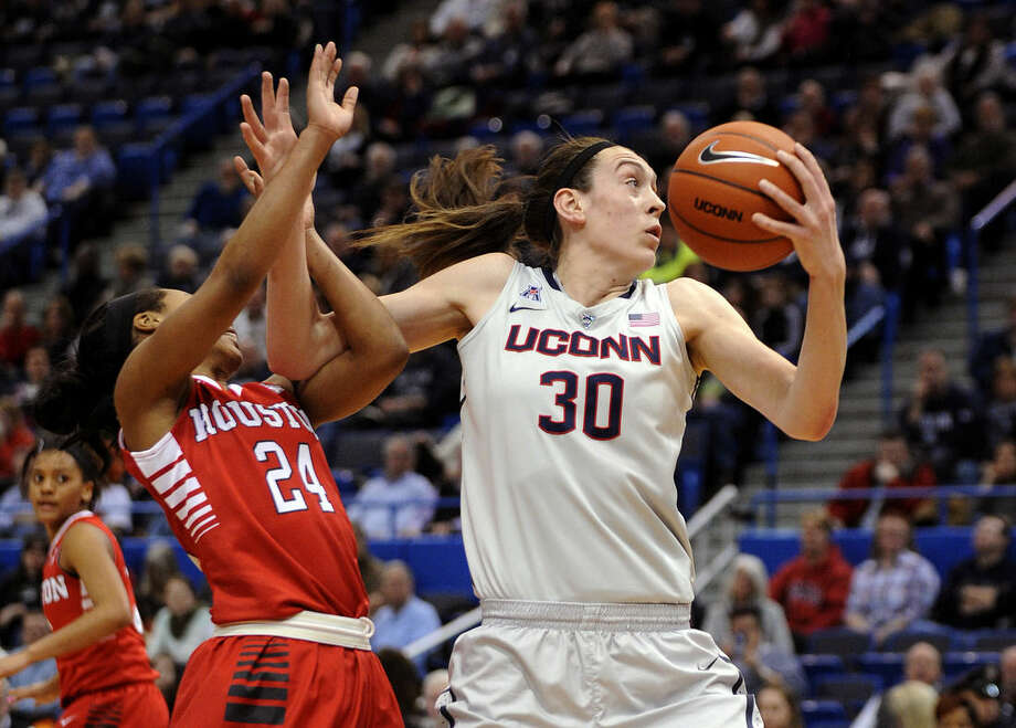 Connecticut's Breanna Stewart (30) is fouled by Houston's Mariah Mitchell (24) during the first half of an NCAA college basketball game in Hartford, Conn., on Tuesday, Feb. 17, 2015. (AP Photo/Fred Beckham)