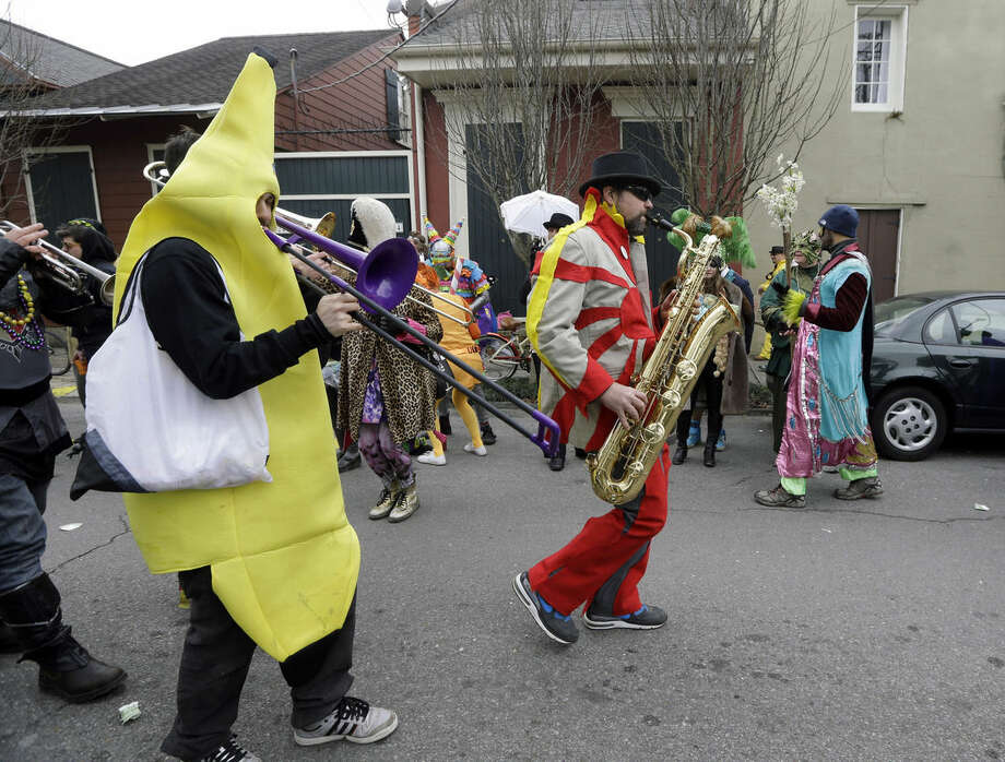 Musicians march in costume during Mardi Gras in New Orleans, Tuesday, Feb. 17, 2015. Revelers in glitzy costumes filled the streets of New Orleans for the annual fat Tuesday bash, opening a day of partying, parades and good-natured jostling for beads and trinkets tossed from passing floats. (AP Photo/Gerald Herbert)
