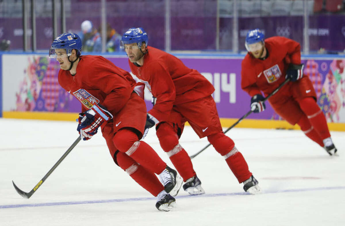 Czech Republic forward Roman Cervenka, forward Petr Nedved and forward Jiri Novotny race around the rink during a training session at the Bolshoy Ice Dome at the the 2014 Winter Olympics, Sunday, Feb. 9, 2014, in Sochi, Russia. (AP Photo/Mark Humphrey)