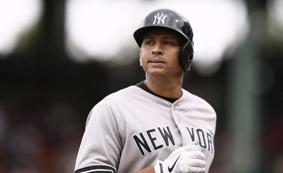 FILE - In this Sept. 14, 2013, file photo, New York Yankees' Alex Rodriguez heads to the dugout during the Yankees' 5-1 loss to the Boston Red Sox in a baseball game at Fenway Park in Boston. Rodriguez has accepted his season-long suspension from Major League Baseball, the longest penalty in the sport's history related to performance-enhancing drugs. Rodriguez withdrew his lawsuits against MLB, Commissioner Bud Selig and the players' association to overturn his season-long suspension on Friday, Feb. 7, 2014. (AP Photo/Winslow Townson, File)