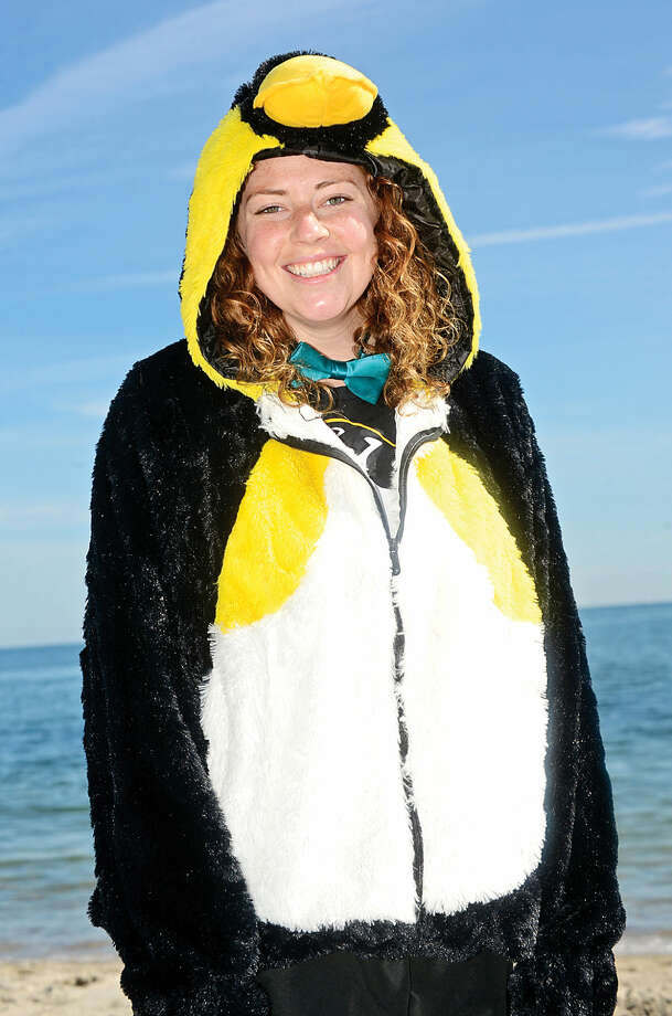 Hour photo / Erik Trautmann Erin Ritz dons festive attire for the 2016 Westport Penguin Plunge at Compo Beach Saturday to benefit The Special Olympics.
