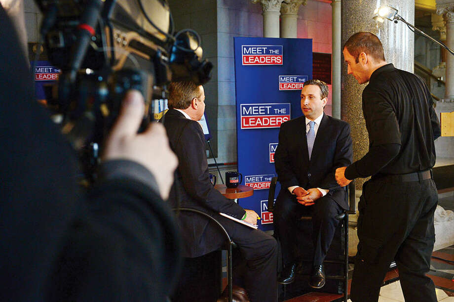 Hour photo / Erik Trautmann New Senate Majority Leader Bob Duff (D-25) is interviewed by Cablevision's Meet the Leaders before the joint legislative session and gubenatorial budget address Wednesday in Hartford.