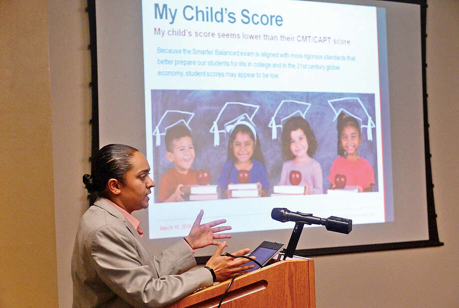 Hour photo / Erik Trautmann Yamuna Menon, Director of Research and Policy for ConnCAN discusses the benefit of K-12 assessments with a focus on SBAC and SAT and how CT results compare to national results. The program was for parents who wish to understand SBAC and individual student testing at the South Norwalk Library Branch Thursday evening.