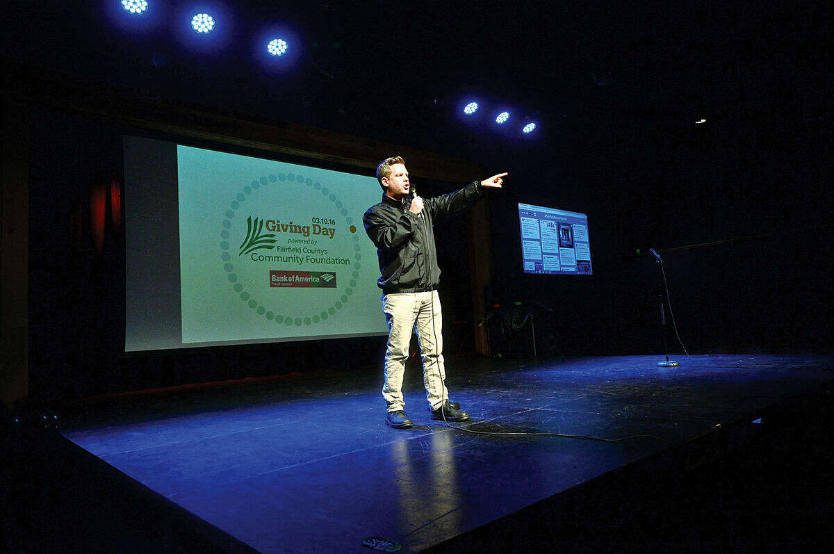 Hour photo / Erik Trautmann STAR 99.9 Program Director Kevin Begley welcomes the crowd at he launch party for Giving Day, a 24-hour fundraising event for Fairfield County nonprofits at The Warehouse at Fairfield Theatre Company Thursday morning.