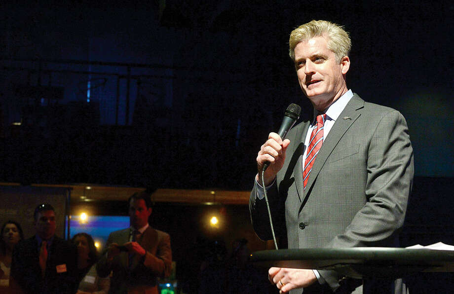 Hour photo / Erik Trautmann Bank of America Southern Connecticut market president, Bill Tommins, addresses the crowd during the launch party for Giving Day, a 24-hour fundraising event for Fairfield County nonprofits at The Warehouse at Fairfield Theatre Company Thursday morning.