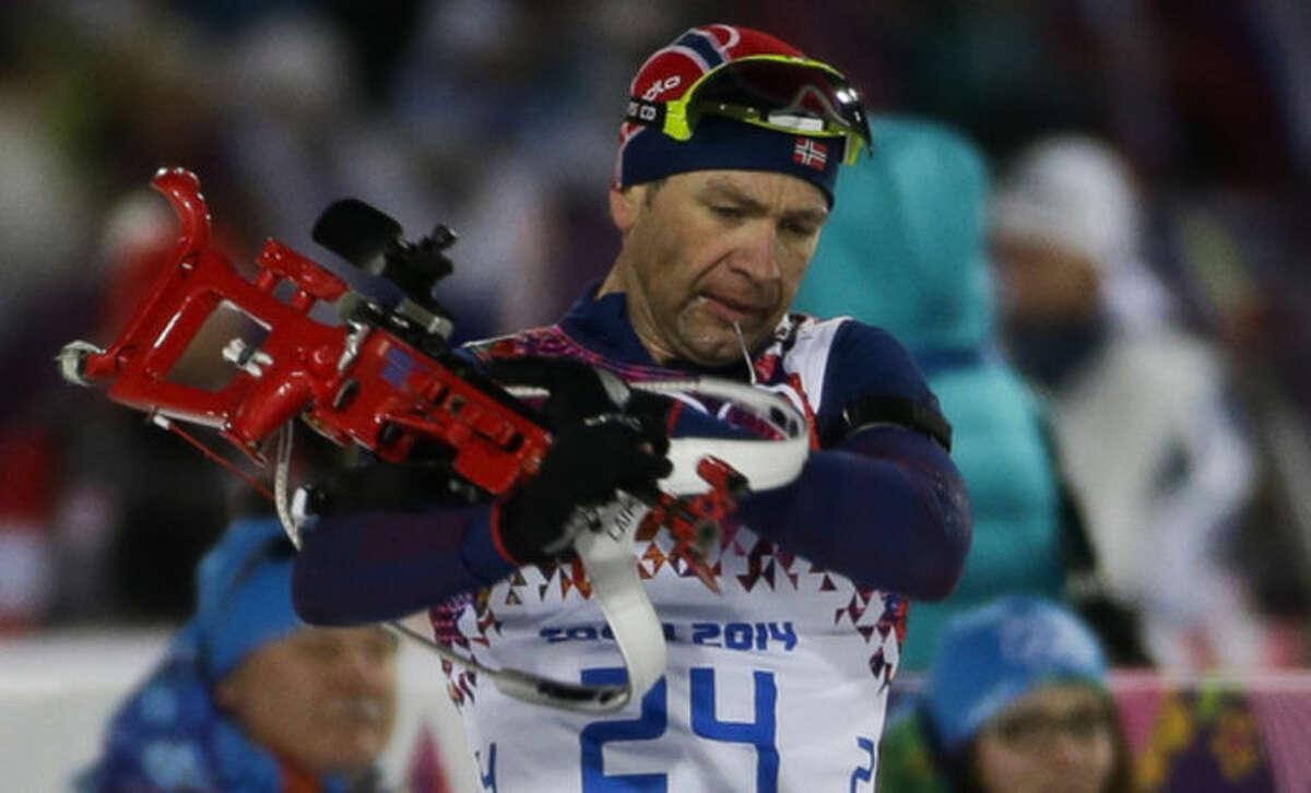 Norway's Ole Einar Bjoerndalen leaves the shooting range during the men's biathlon 10k sprint, at the 2014 Winter Olympics, Saturday, Feb. 8, 2014, in Krasnaya Polyana, Russia. Norway's Ole Einar Bjoerndalen won the gold. (AP Photo/Gero Breloer)