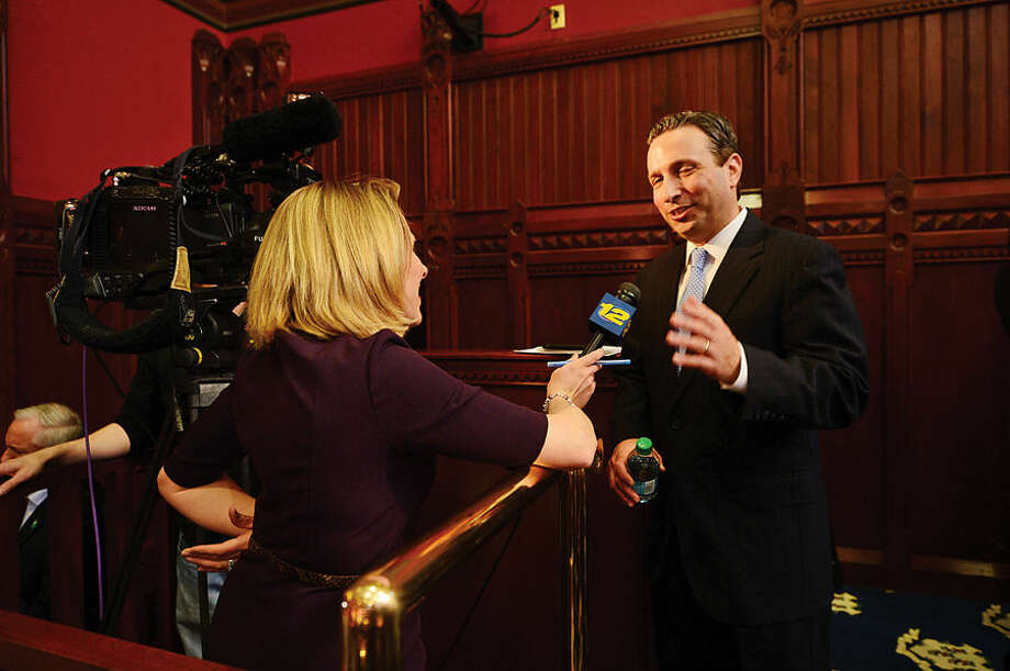 Hour photo / Erik Trautmann New Senate Majority Leader Bob Duff (D-25) is interviewed by the press following the joint legislative session and gubenatorial budget address wednesday in Hartford