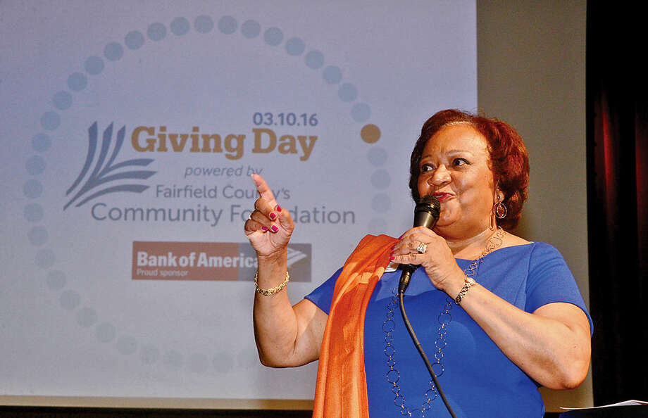 Hour photo / Erik Trautmann Juanita James, CEO of the Fairfield County Community Fioundation, welcomes guest and sponsors during the launch party for Giving Day, a 24-hour fundraising event for Fairfield County nonprofits at The Warehouse at Fairfield Theatre Company Thursday morning.