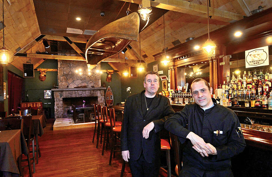 Owner Eric Monte and chef Remis Saget sit at the bar at Tavern 489, Glenbrook's newest restaurant.
