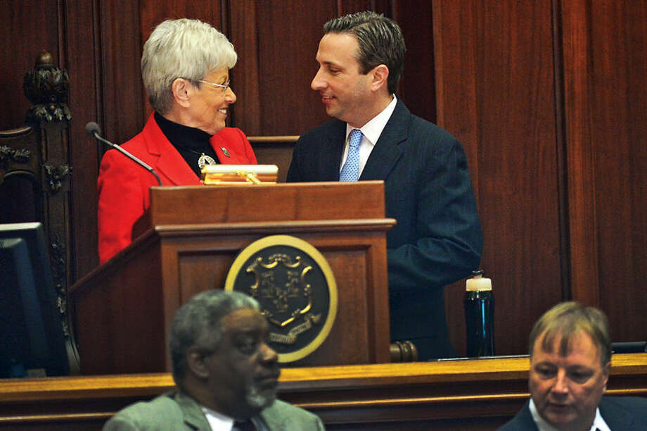 Hour photo / Erik Trautmann New Senate Majority Leader Bob Duff (D-25) is welcomed by Lieutenant Governor Nancy Wyman in senate chambers before the joint legislative session and gubenatorial budget address Wednesday in Hartford.