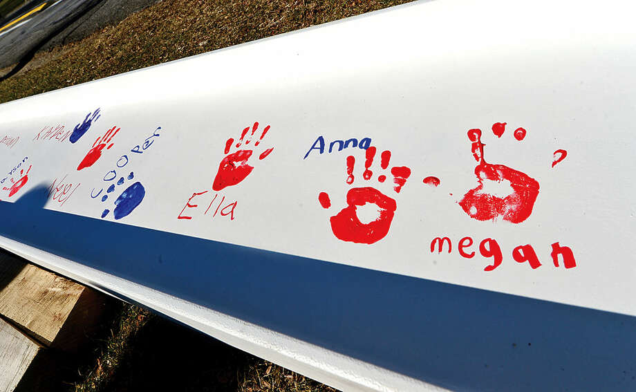 Hour photo / Erik Trautmann Miller-Driscoll School students sign and put their handprints on steel beams to be incorporated in the new construction of the $50-million renovation project Wednesday at the school.