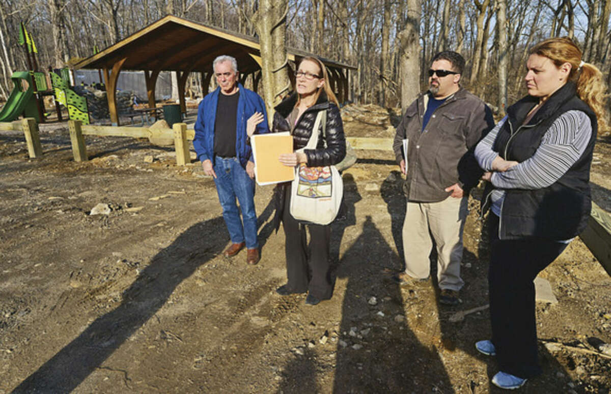 Hour photo / Erik Trautmann Diane Lauricella, second from left, leads the newly formed neighborhood association, The Cranbury Preservation Association, including members Tony Guaglione, Matt Forte and Patty Ruffo, in an effort to curtail development of the southern area of Cranbury Park. The group held a press conference at Cranbury Park Tuesday to highlight their efforts to stop a proposed Zip Line.