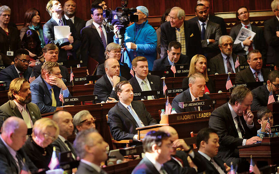 Hour photo / Erik Trautmann Bob Duff (D-25) conducts business as new Senate Majority Leader in the joint legislative session and gubenatorial budget address Wednesday in Hartford