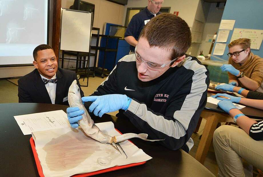 Hour Photo/Alex von Kleydorff MaritimeAquarium President and CEO Dr. Brian Davis watches as South Kent School Senior Ryan Sweeney takes a closer look at a Dog Fish Shark during an Evolution program.