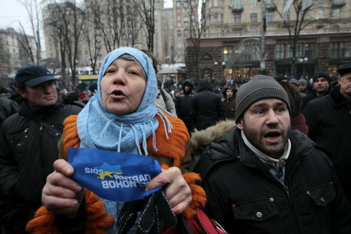 Supporters of Ukrainian President Viktor Yanukovych arguing with a anti-government protesters in Kiev, Ukraine, Saturday, Feb. 8, 2014. Thousands of people angered by months of anti-government protests in the Ukrainian capital converged on one of the protesters' barricades Saturday, but retreated after meeting sizeable resistance.(AP Photo/Sergei Chuzavkov)