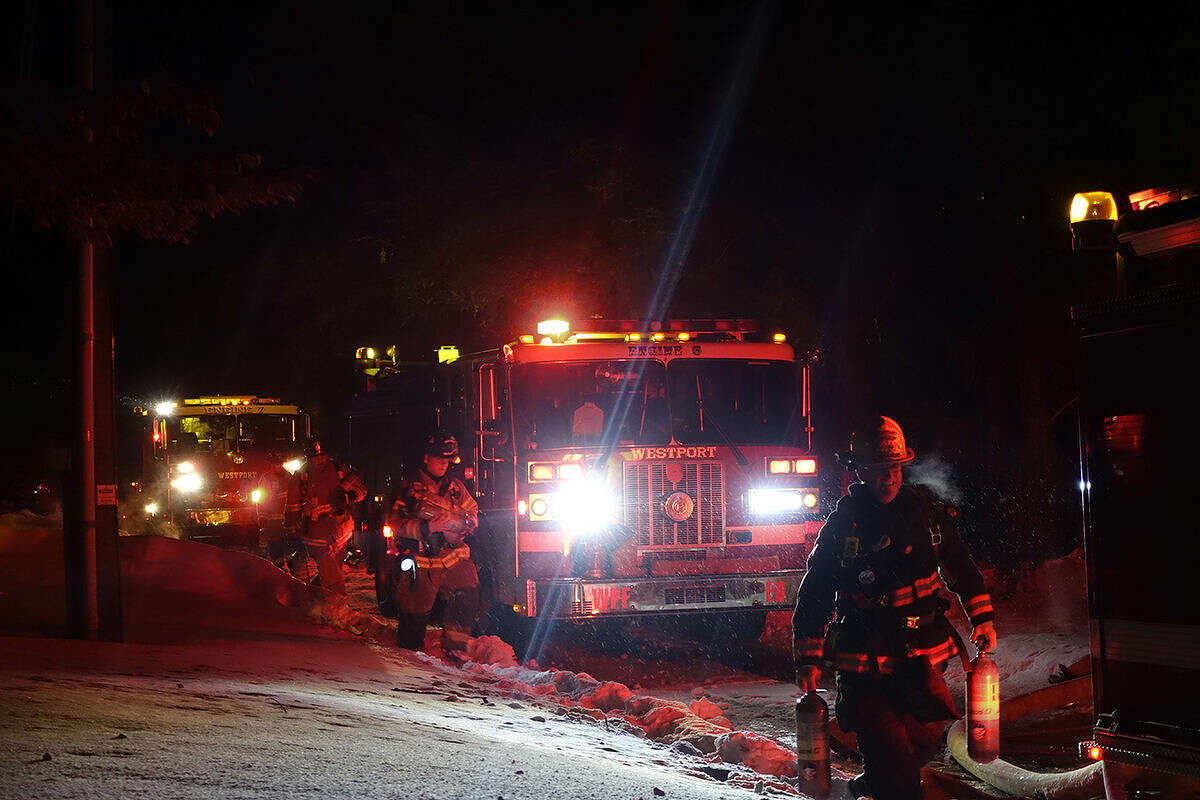 Hour photo/Jeff Dale Westport and Wilton Fire reponds to a small fire at 12 Weathervane Hill Road in Westport Wednesday night.
