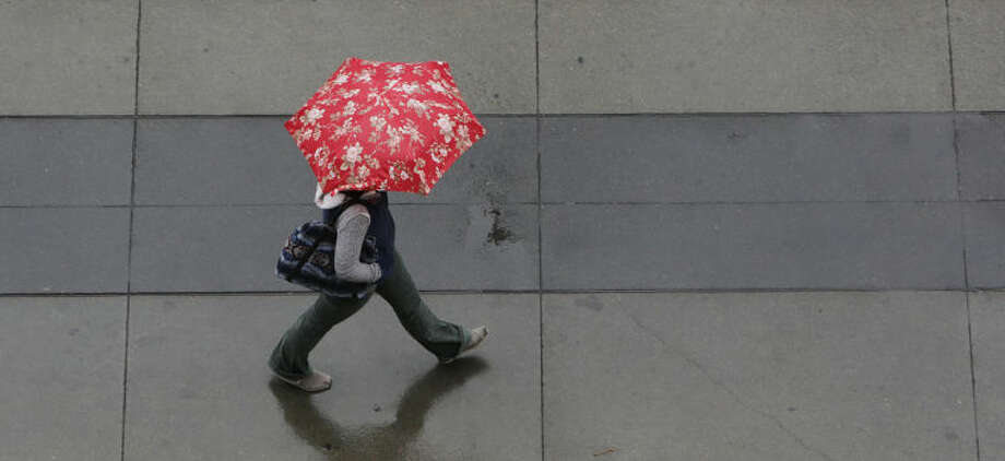 Umbrellas were put to good use as showers swept through Sacramento, Calif., Friday, Feb. 7, 2014. Drought-stricken California is getting some relief as a storm system the likes of which, forecasters say, the region has not seen in more than a year.(AP Photo/Rich Pedroncelli)