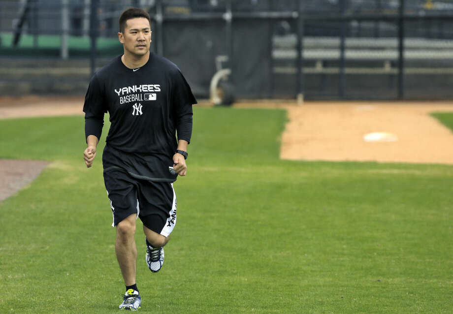 New York Yankees pitcher Masahiro Tanaka, of Japan, runs after working out at the Yankees' minor league complex Tuesday, Feb. 17, 2015, in Tampa, Fla. (AP Photo/Chris O'Meara)