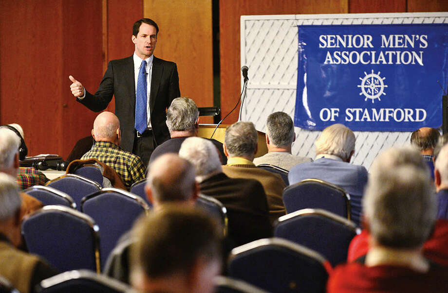 Hour photo / Erik Trautmann U.S. Representitive Jim Himes speaks on a variety of issues to The Senior Men's Association at the Temple Agudath Shalom on Strawberry Hill Avenue in Stamford Thursday.