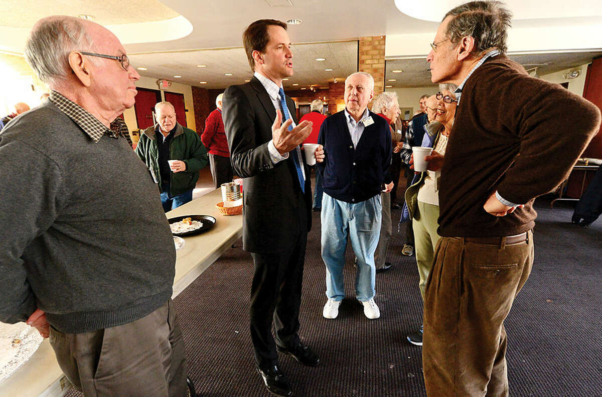 Hour photo / Erik Trautmann U.S. Representitive Jim Himes visits with members of The Senior Men's Association at the Temple Agudath Shalom on Strawberry Hill Avenue in Stamford Thursday.