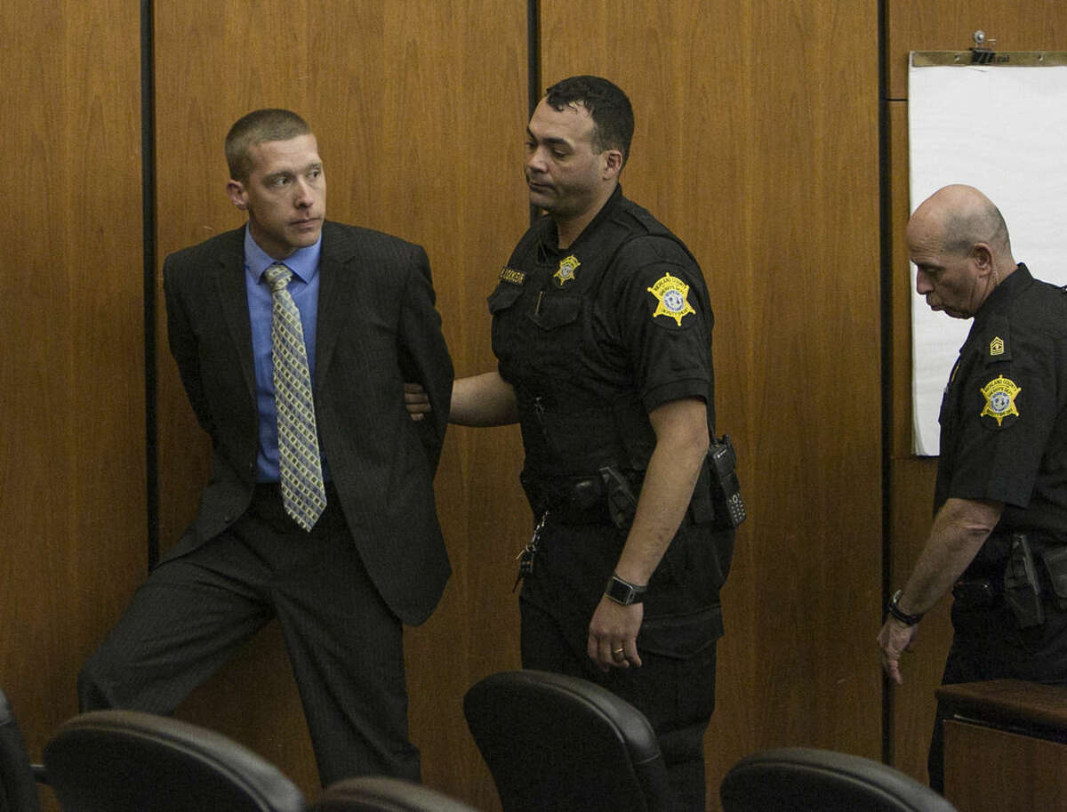 Ex-Trooper Sean Groubert, left, looks back at his wife as he is taken into custody after he pleaded guilty Monday, March 14, 2016, to the charge of assault and battery of high and aggravated nature for the 2014 shooting ofLevar Jones during a traffic stop. Groubert will be sentenced later. He faces up to 20 years for assault and battery of a high and aggravated nature. There is no minimum sentence. (Tim Dominick/The State via AP) ALL LOCAL MEDIA OUT, (TV, ONLINE, PRINT); MANDATORY CREDIT