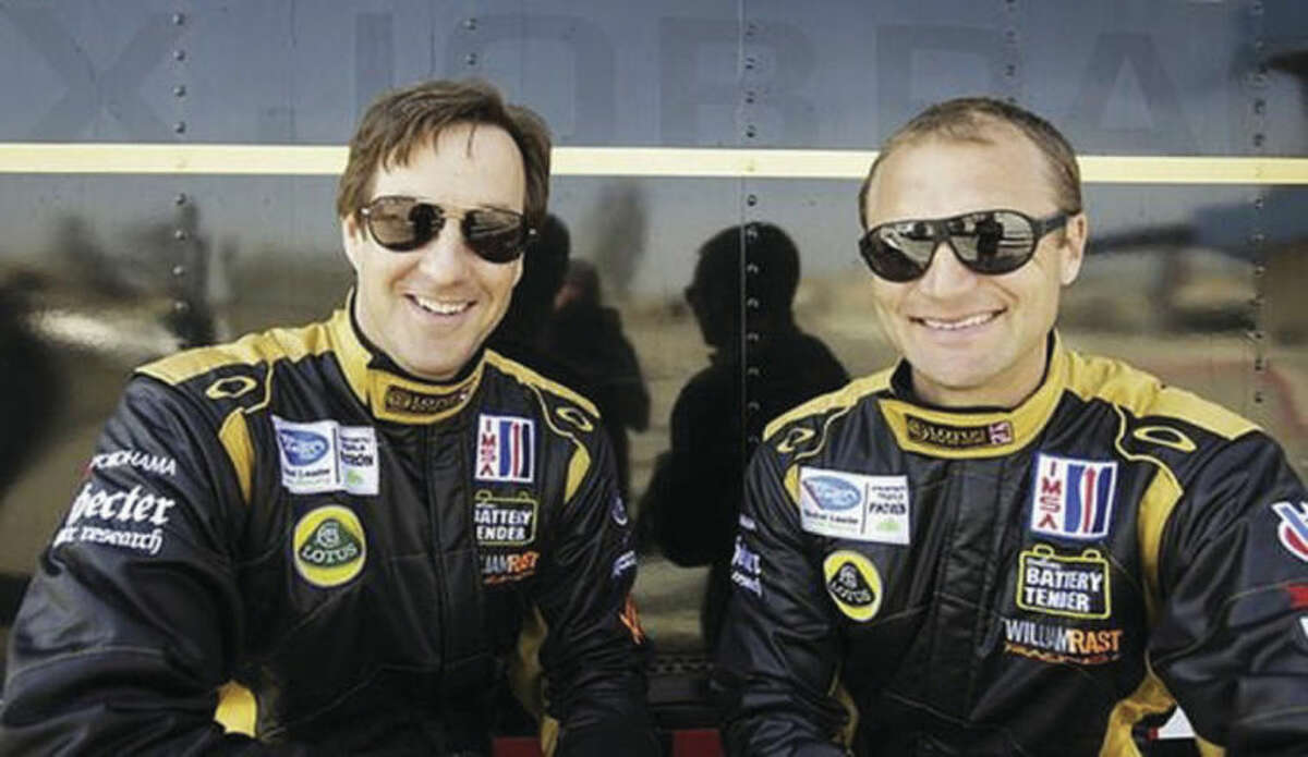 Photo courtesy of Level 5 Motorsports - Westport's Bill Sweedler, left, pauses with teammate Townsend Bell during a race for Level 5 Motorsports.