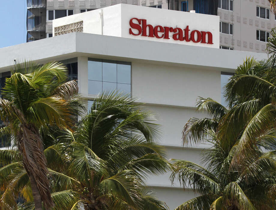 FILE - This July 25, 2011, file photo, shows the Sheraton Fort Lauderdale Beach Hotel, a member of the Starwood Hotels and Resorts group, in Fort Lauderdale, Fla. A fight for control of the Starwood hotel chain is under way after a buyout offer from a consortium led by China's Anbang Insurance Group. Starwood Hotels & Resorts Worldwide Inc. said Monday, March 14, 2016, that it still favors the bid from Marriott, but that it's looking at the latest bid. (AP Photo/Wilfredo Lee, File)