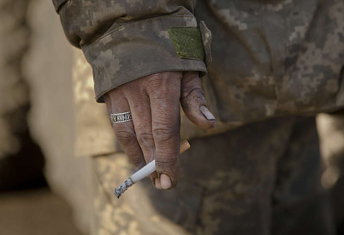 A Ukrainian serviceman wearing a ring engraved with a fragment of an Orthodox prayer that reads