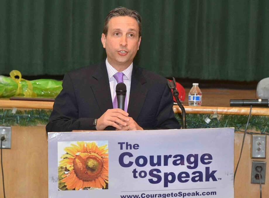 Hour Photo/Alex von Kleydorff Senator Bob Duff reads a message from The Office of the President, Office of National Drug Control Policy during the 12th annual Courage to Speak Empowering Youth to be Drug Free family Night at West Rocks School