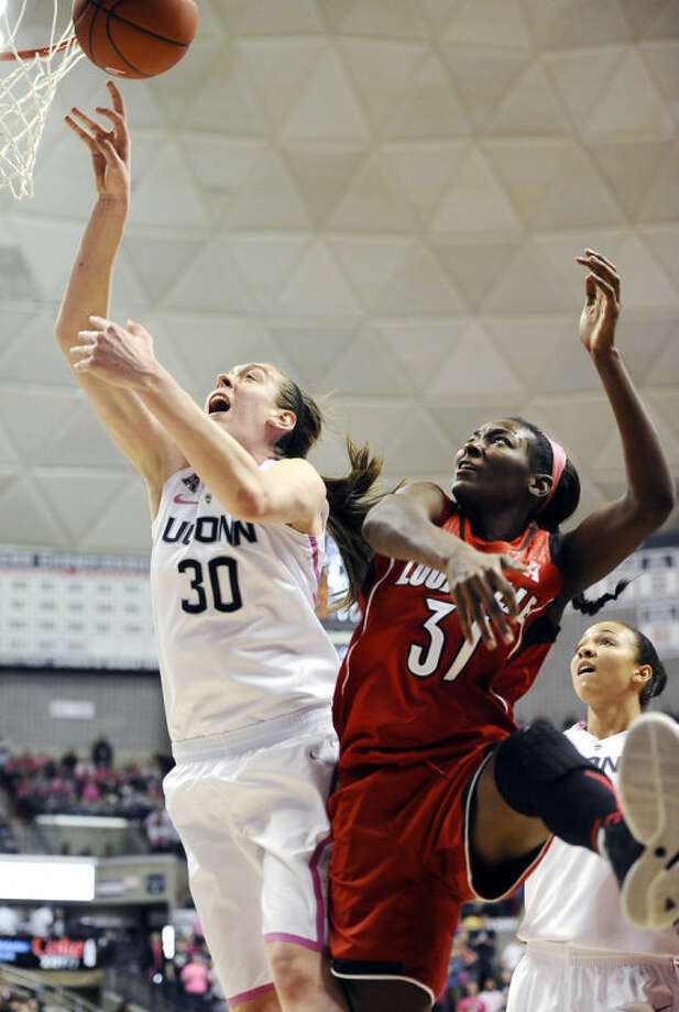 Connecticut's Breanna Stewart, left, and Louisville's Asia Taylor, battle for a rebound during the second half of an NCAA women's college basketball game, Sunday, Feb. 9, 2014, in Storrs, Conn. Connecticut won 81-64. (AP Photo/Jessica Hill)