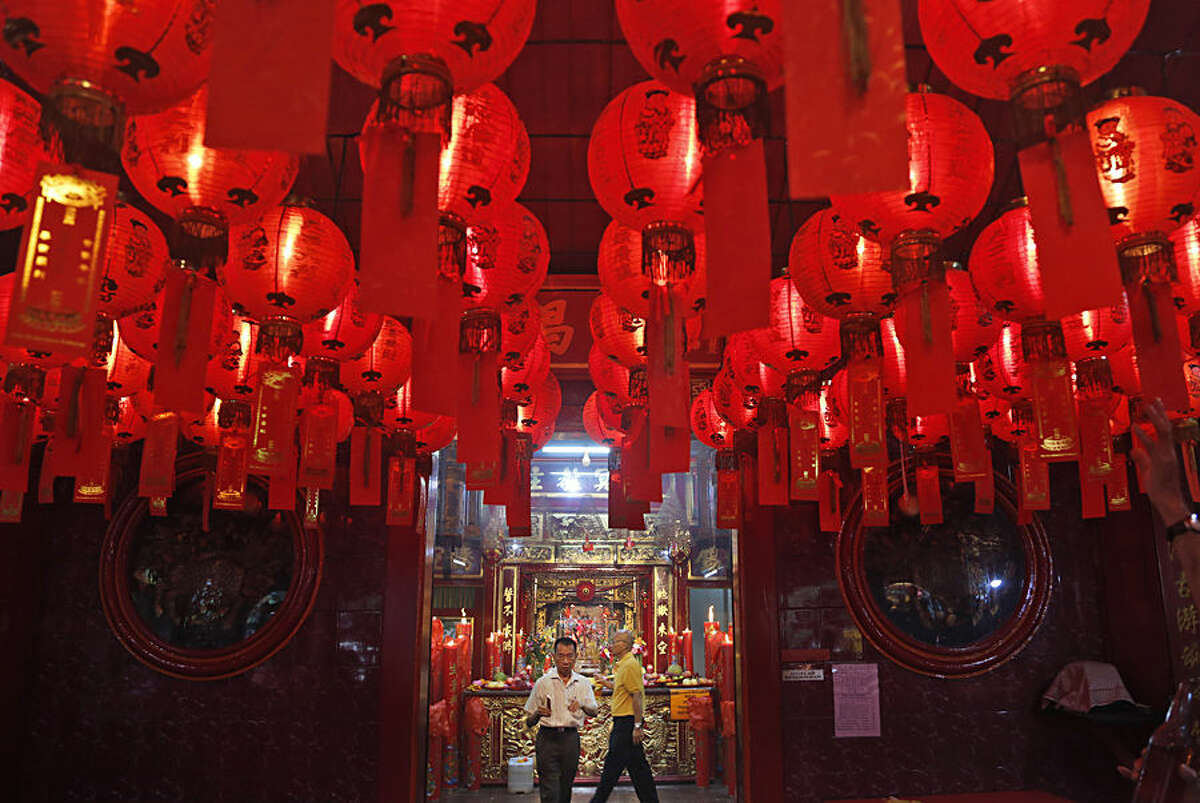 Indonesians of Chinese descent attend a prayer during Chinese New Year celebration at Dharma Sakti temple at the China Town in Jakarta, Indonesia, Thursday, Feb. 19, 2015. Ethnic Chinese in the world's most populous Muslim country are celebrating the start of the year of the sheep. (AP Photo/Dita Alangkara)